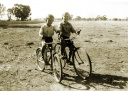 Riding the bikes Fred and George Jones, Koonda. 1950s