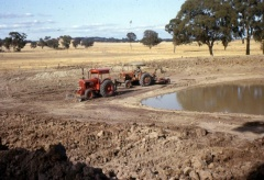 Mud scooping house dam, Upotipotpon. 1970's